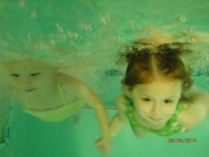 Babies holding hands underwater